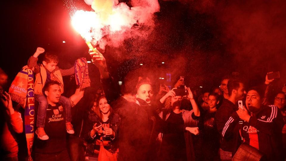 FC Barcelona football fans celebrate the club's 25th La Liga title victory in Barcelona on Sunday.  (AFP)