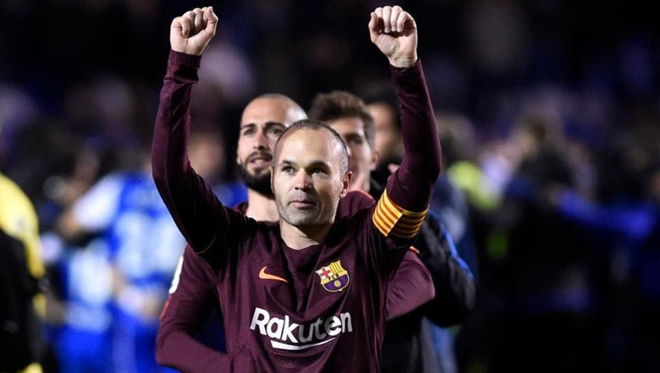 FC Barcelona's Andres Iniesta celebrates after his team won the Spanish La Liga beating Deportivo La Coruna on Sunday. (AFP)