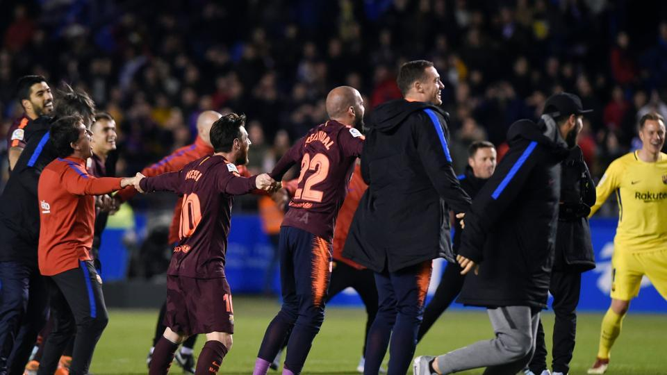 FC Barcelona players rejoice after winning the Spanish league football match against Deportivo Coruna and claiming their 25th La Liga at the Riazor stadium in Coruna.