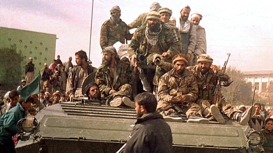 Security forces from the Northern Alliance group entering Kabul, during the fall of the Taliban regime on November 13, 2001. Marai was one of the few reporters to cover the bombing of Kabul ahead of the US invasion. (Shah Marai / AFP File)