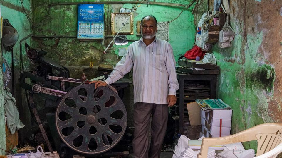 Syed Ahmed, 50, owns and operates a letterpress printing machine in Delhi, India. There are only five other such operators in the city according to Ahmed, who says he is the last one in his family working in the tradition. Growing out of the printing press invented by Johannes Gutenberg in the mid-15th century, Letterpress printing remained in wide use for book and newspaper production until overtaken by digital replacements. (Chandan Khanna / AFP)