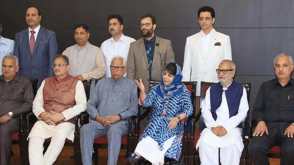Jammu & Kashmir governor NN Vohra and chief minister Mehbooba Mufti pose for a photograph with newly appointed deputy chief minister Kavinder Gupta other cabinet ministers after a reshuffle in Jammu. (PTI)