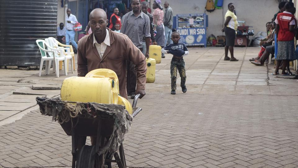 The lack of running water in Kenya's poorest neighbourhoods has, for the last 18 years, meant a living for Samson Muli, a water seller in Nairobi. The margins are tiny -- he buys water at five shillings ($0.05) a can and sells for 15, but the job allows him to pay his children's school fees on time. With Kenya's gradual development, including piped water, Muli's profitable days are numbered. (Simon Maina / AFP)