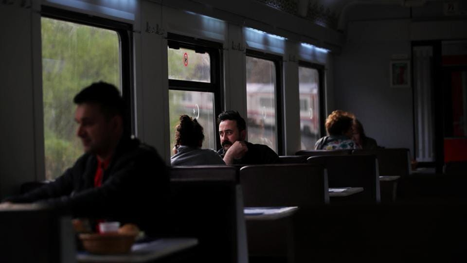 Passengers eat and chat on board the Eastern Express travelling through Erzincan province. For most people on board, the 24-hour ride is a sure-shot to meeting new people, travelling with parties in every compartment and with fellow passengers on a journey that is the destination itself. (Umit Bektas / REUTERS)