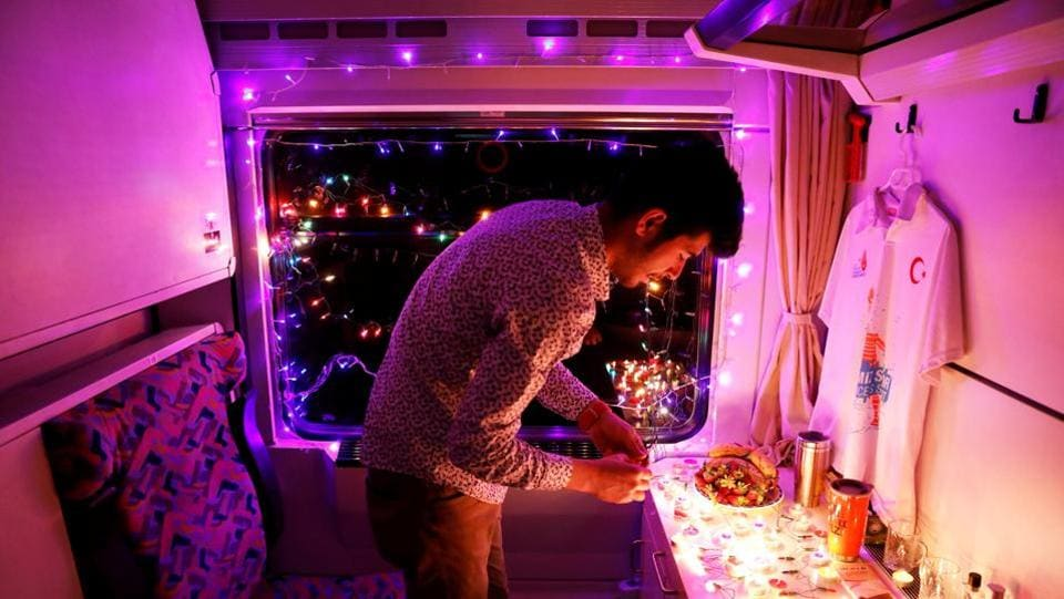 Not everyone, however, is making their dream journey. University student Sinan Usta, who decorated his cabin with candles and rainbow-coloured flashing lights for his girlfriend, spent the journey sitting alone in his little room. (Umit Bektas / REUTERS)