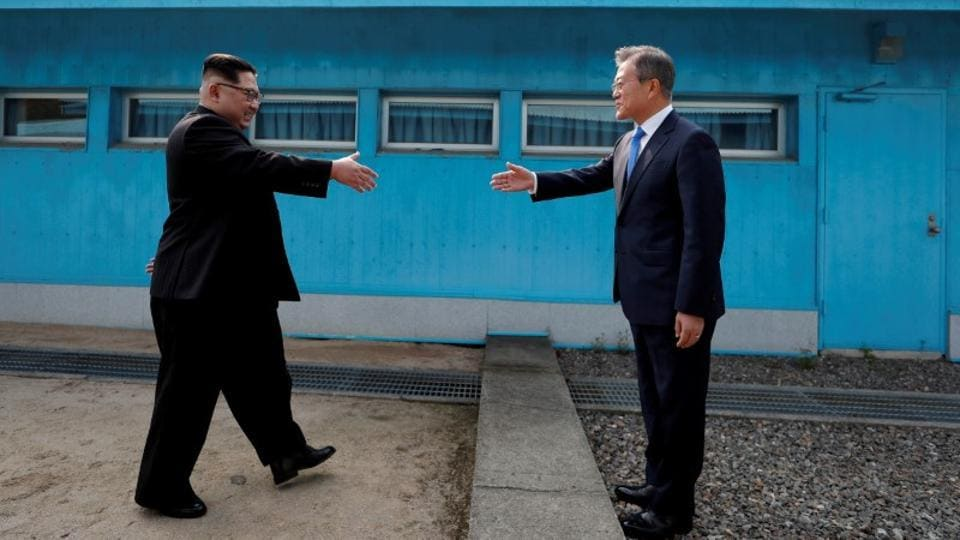 North Korean leader Kim Jong-un walks up to South Korean President Moon Jae-in at the truce village of Panmunjom inside the demilitarized zone separating the two Koreas, South Korea, April 27, 2018