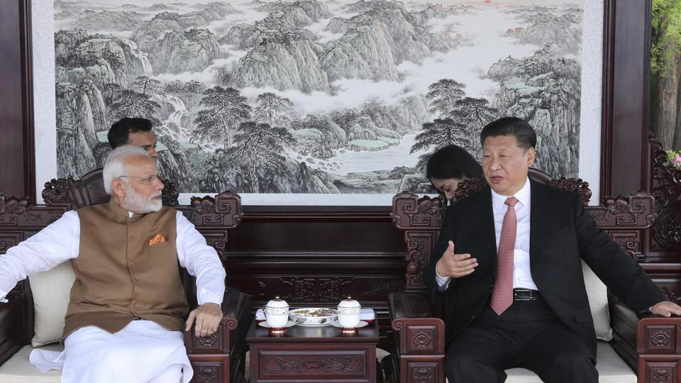 Prime Minister Narendra Modi, left, and Chinese President Xi Jinping talk during a meeting in Wuhan in central China's Hubei Province, Saturday, April 28, 2018.