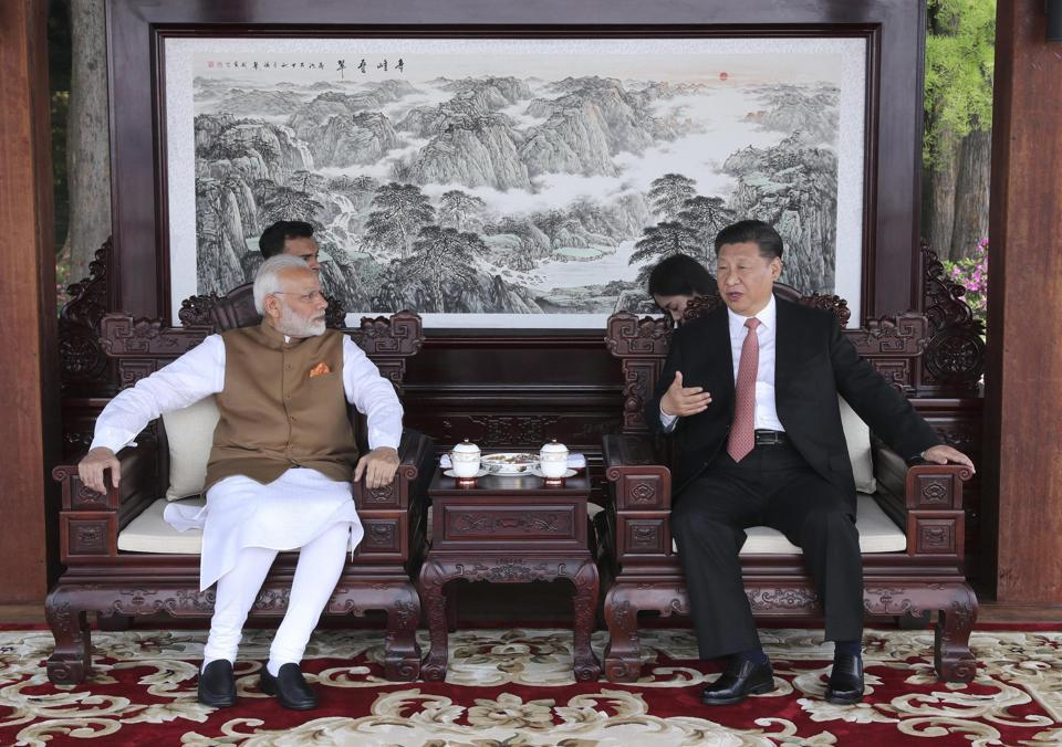 Prime Minister Narendra Modi and Chinese President Xi Jinping talk during a meeting in Wuhan in central China's Hubei Province, Saturday, April 28, 2018.