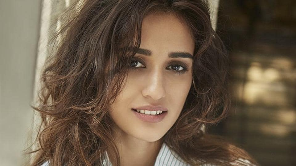 Disha Patani slammed a news channel that called her 'ugly' while comparing her childhood picture in school dress with her recent photos.