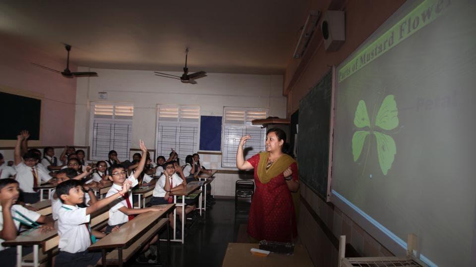 Teachers using videos, cartoons, presentations to teach kids.