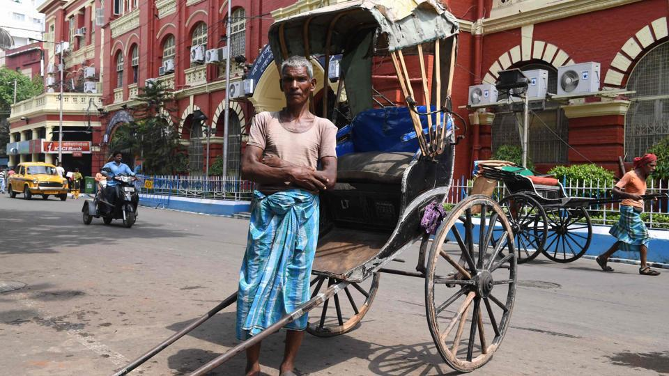 Mohammad Ashgar, 65, is a rickshaw puller in Kolkata, India. A mainstay of 19th century transportation, the hand-pulled rickshaw survives in India only in Kolkata. Ashgar is among a dying breed still eking a living from this back-breaking labour. Their numbers are declining as pulled rickshaws are relegated to history, usurped by autorickshaws, Kolkata's famous yellow taxis and modern conveniences like Uber. (Dibyangshu Sarkar / AFP)