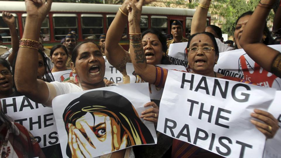 A file photo, of Indian activists in Mumbai holding placards demanding rapists be hanged