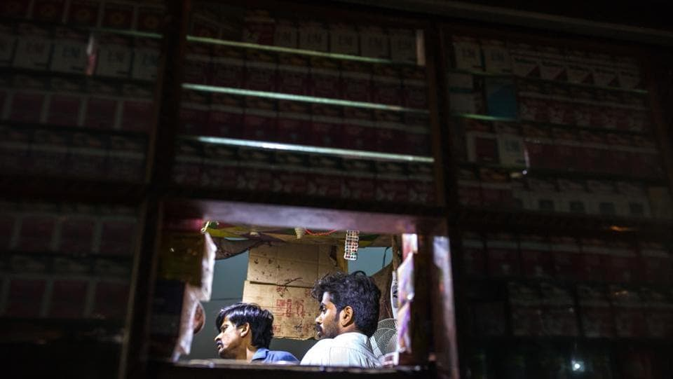 Vendors are illuminated by solar-powered bulbs at a stall at night in Sujawal. Solar and wind energy contributed 3 percent to Pakistan's electricity generation, or about 300 megawatts as of March, according to brokerage firm Arif Habib Ltd. (Asim Hafeez / Bloomberg)