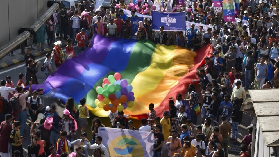 People participate in a parade supporting gay sex at August Kranti Maidan in Mumbai on January 28, 2017.