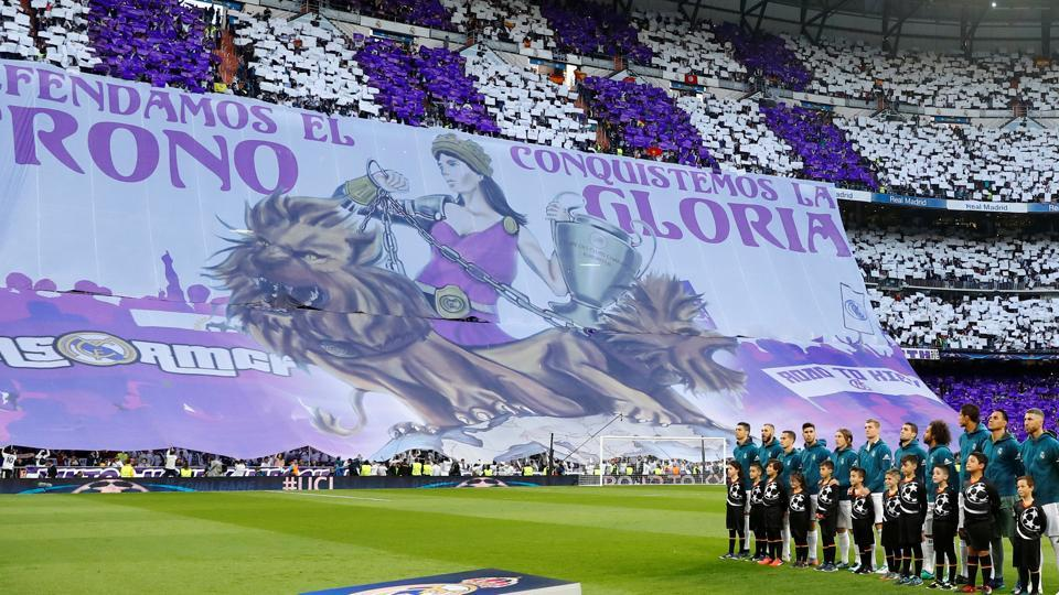 Real Madrid players line up before the match against Bayern Munich as fans display a banner at Santiago Bernabeu. (REUTERS)