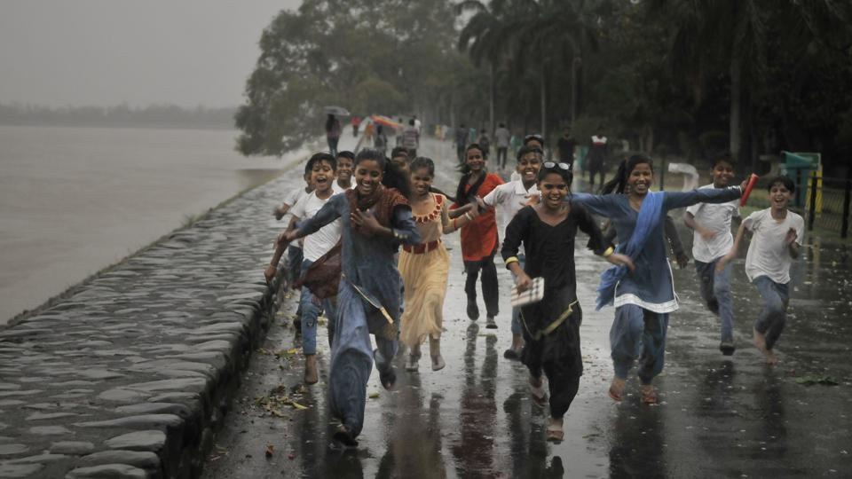 Kids enjoying the rain at the Sukhna Lake after days of heat waves in Chandigarh on Wednesday.  (Karun sharma/ht)