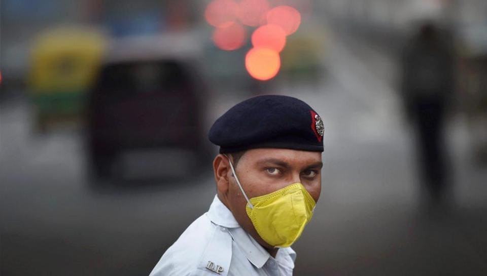 In this file photo, a traffic policeman wears an anti-pollution mask to protect himself from air pollution.