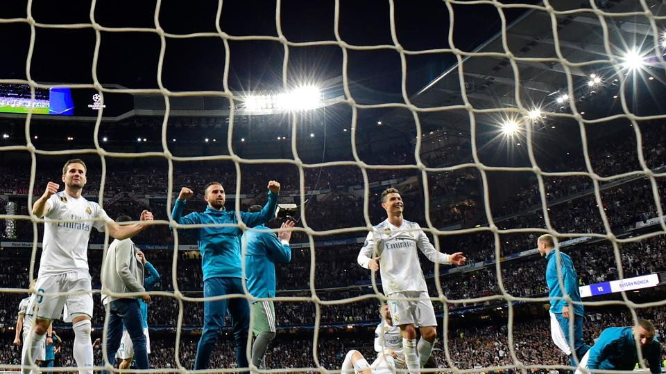 Real Madrid players celebrate at the end of the UEFA Champions League semi-final second leg football match against Bayern Munich and making it to final for a third consecutive year. (AFP)