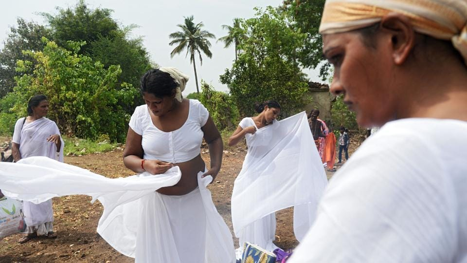 Transgender devotees dress in white saris after a ritual signifying their marriage to the warrior god Aravan at the Koothandavar Temple in the village of Koovagam, Tamil Nadu. Devotees from all over India gather at the Koothandavar Temple each year during the full moon of the Tamil month of Chitrai, to participate in the re-enactment of a tale of the epic Mahabharata. (Arun Sankar / AFP)