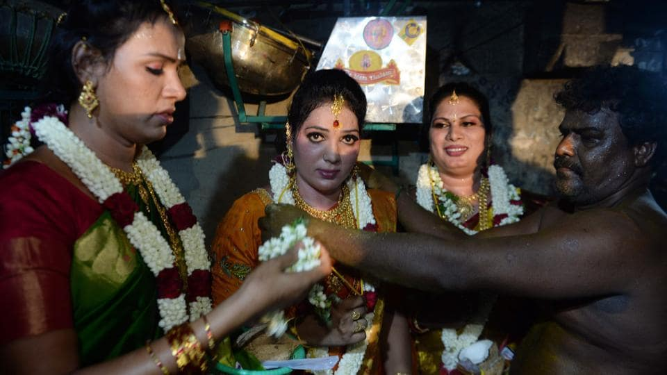 A Hindu priest embodying Aravan performs the marriage at the Koothandavar temple. According to the Mahabharata, Aravan agreed to be sacrificed to the goddess Kali in order to ensure the Pandava's success in the battlefield against the Kauravas, under the condition that he is married before he dies.  (Arun Sankar / AFP)