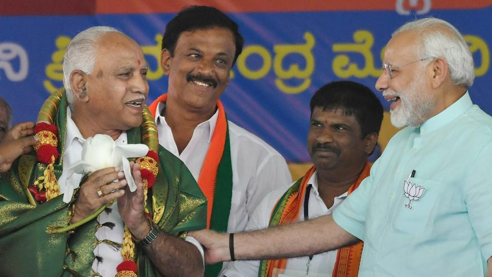 BJP's chief ministerial candidate BS Yeddyurappa and Prime Minister Narendra Modi during a campaign rally ahead of the Karnataka election at Chamarajanagar on Tuesday.