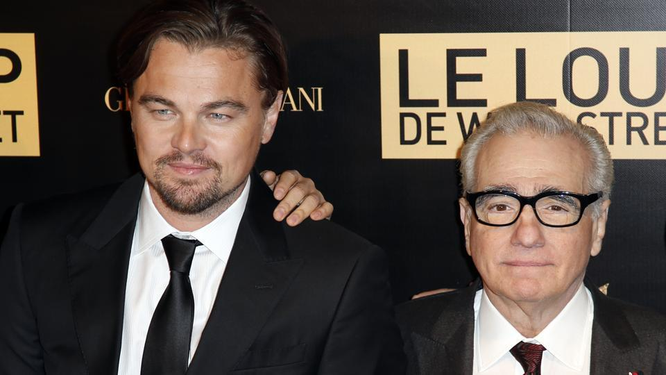 Leonardo Di Caprio, left, and director Martin Scorsese arrive for the screening of their film, The Wolf of Wall Street, in Paris.