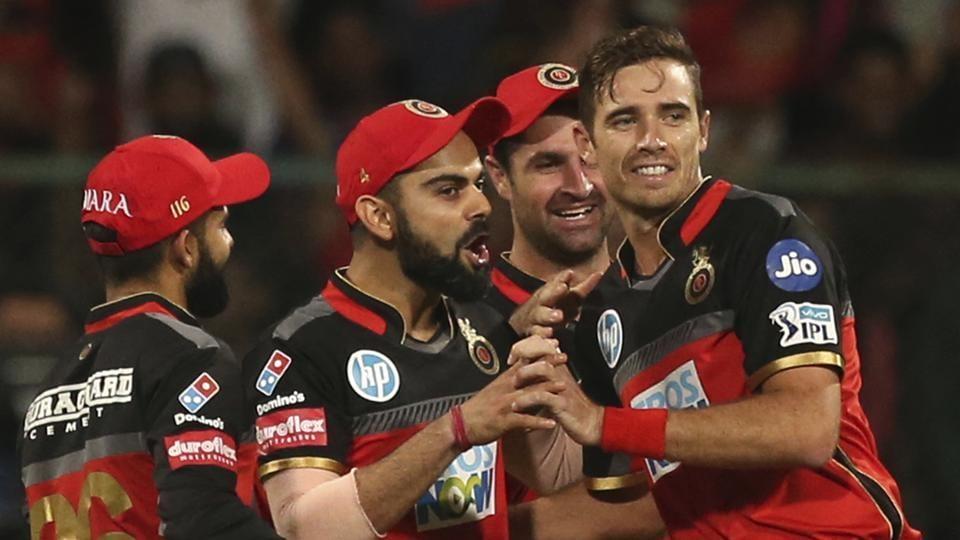 Royal Challengers Bangalore (RCB)captain Virat Kohli (2nd left)celebrates with teammates after the fall of Mumbai Indians batsman Hardik Pandya during 2018 Indian Premier League (IPL2018)match in Bengaluru on Wednesday.  (AP)
