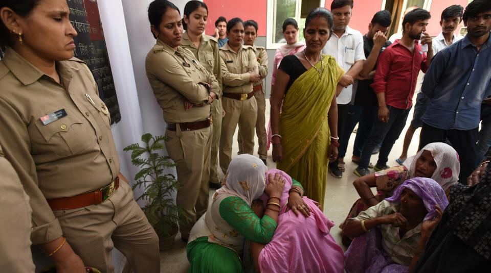 Relatives of Kavita, who died in police custody, protest at Noida's sector 49 police station.