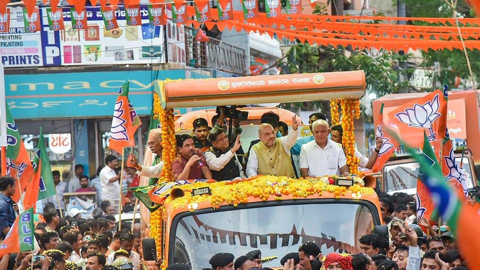 Bharatiya Janata Party president Amit Shah with party leaders during a road show in Hubli on April 12.