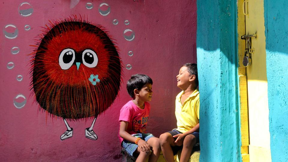A view of a painted wall at Bhim Nagar Chawl in Bhoiwada, Parel, in central Mumbai. The group Green Habit is behind this project, which revamped the area with vibrantly coloured walls, graffiti and art installations. (Bhushan Koyande/HT PHOTO)