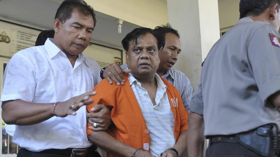 Police escort Chhota Rajan at police headquarters in Denpasar, Bali, on November 2, 2015. Rajan was deported from Indonesia's Bali in November 2015 and subsequently made an accused in the J Dey murder case.