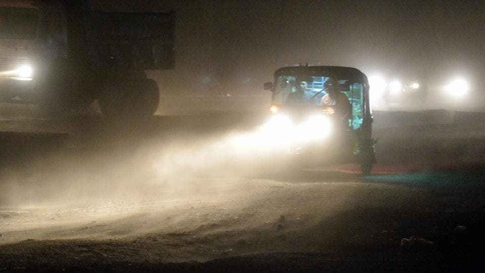 This photo taken on May 2, 2018 shows an auto rickshaw driving through a dust storm in Mathura, Uttar Pradesh.