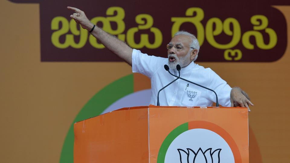 Prime Minister Narendra Modi gestures to supporters during an election campaign rally in Bangalore on May 3.
