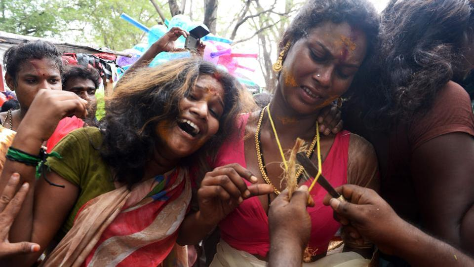 Devotees mourn the death of Aravan as priests break their bangles and snap the thalis. The Koovagam version of the story includes Krishna's mourning as a widow the day after, once Aravan's sacrifice is complete. Krishna then returns to his masculine form for the war. (Arun Sankar / AFP)