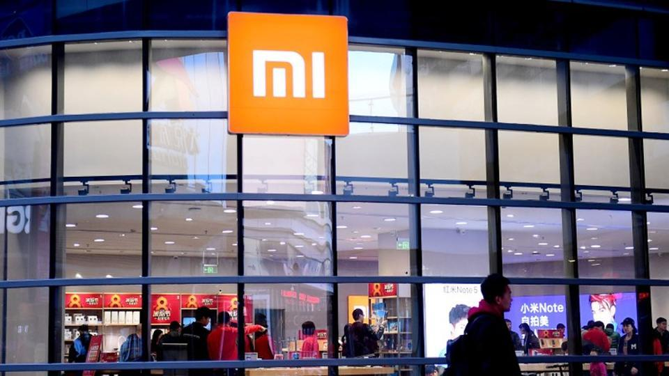 A man walks past a Xiaomi store in Shenyang, Liaoning province, China.