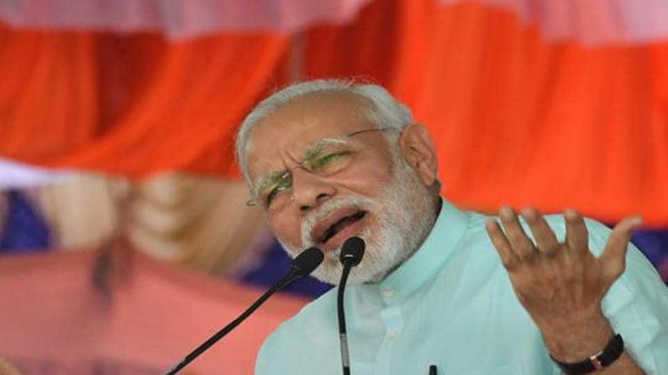 Prime Minister Narendra Modi speaks during Karnataka election campaign rally at Chamarajanagar on Tuesday.