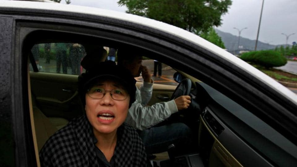 Chinese Nobel winner's widow 'ready to die' to protest custody