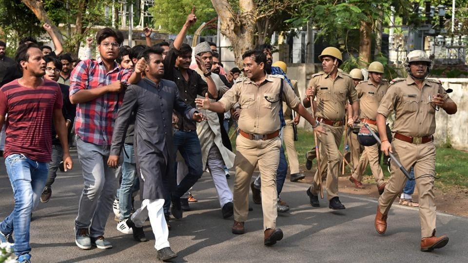 Police try to quell protests at the Aligarh Muslim University on Wednesday.