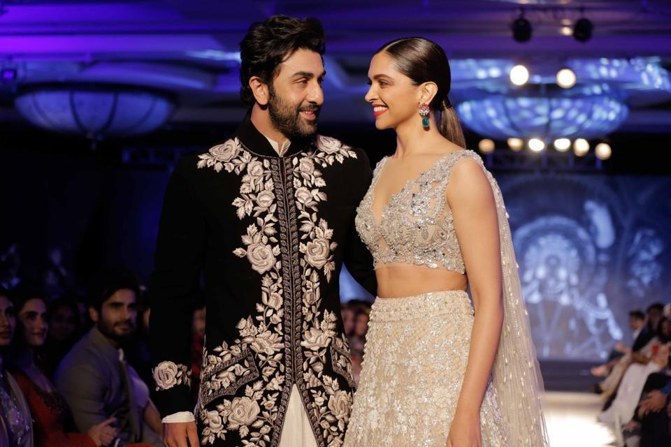 Ranbir Kapoor and Deepika Padukone showcase creation of fashion designer Manish Malhotra at The Walk of Mijwan in Mumbai.