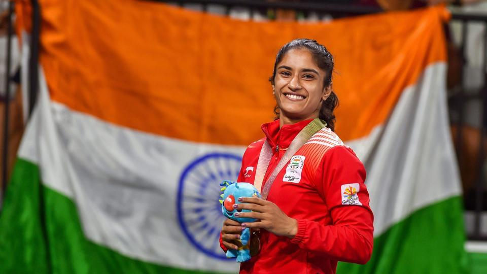 Vinesh Phogat, from the Phogat famlily which broke a glass ceiling in Indian wrestling through their champion women grapplers, celebrates her gold medal at in the women's 55kg event at the 2018 Commonwealth Games (CWG 2018) in Gold Coast last month.