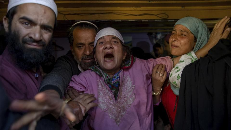 Grandmother (C) of Haseeb Ahmad Khan, one among three civilians killed, wails during his funeral in Kashmir's Baramulla on May 1, 2018. (Dar Yasin / AP)