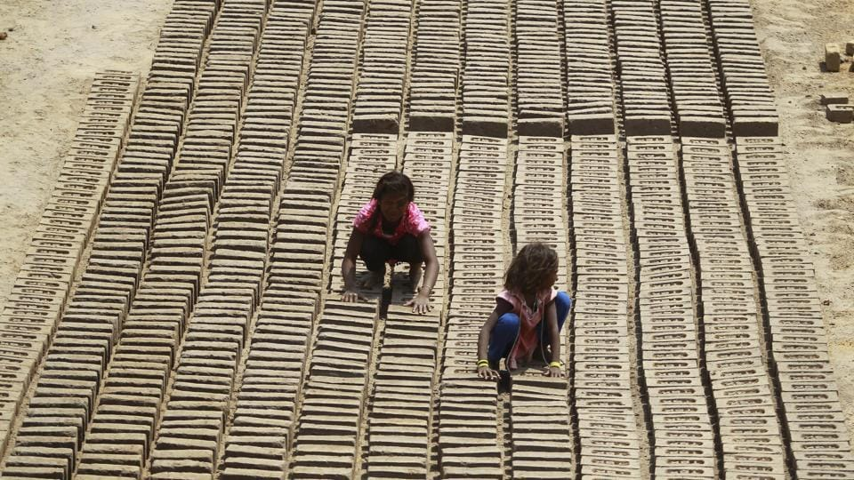 Children work at a brick factory on the outskirts of Jammu city in Jammu and Kashmir on May 1, 2018. International Labour Day also known as May Day was marked across the world on May 1. (Channi Anand / AP)
