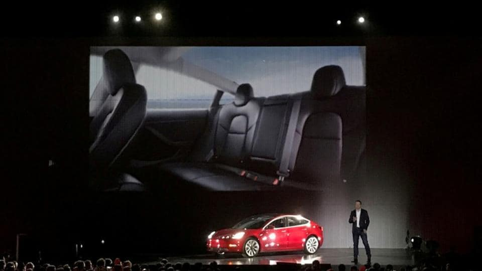 Tesla chief executive Elon Musk introduces one of the first Model 3 cars off the Fremont factory's production line during an event at the company's facilities in Fremont, California, US, July 28, 2017.