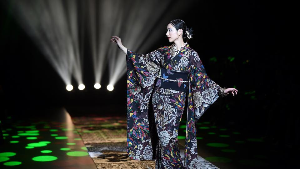 A model presenting a creation by Japanese kimono designer Jotaro Saito for his 2018 autumn/winter collection at Tokyo Fashion Week in Tokyo.