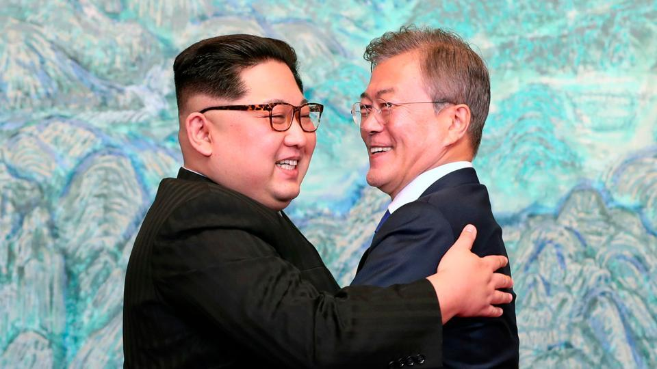 North Korean leader Kim Jong Un, left, and South Korean President Moon Jae-in embrace each other after signing a joint statement at the border village of Panmunjom in the Demilitarized Zone, South Korea on April 28.
