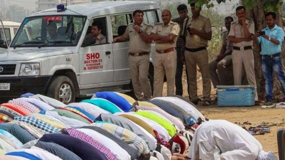 File photo of Muslim community members offering namaz as police personnel look on, in Gurugram.