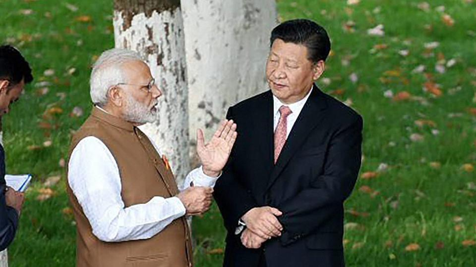 Prime Minister Narendra Modi and Chinese President Xi Jinping take a walk together along the East Lake in Wuhan, China, on April 28, 2018.