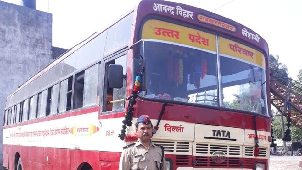 A seized bus with identification line 'UP Pariwar'.