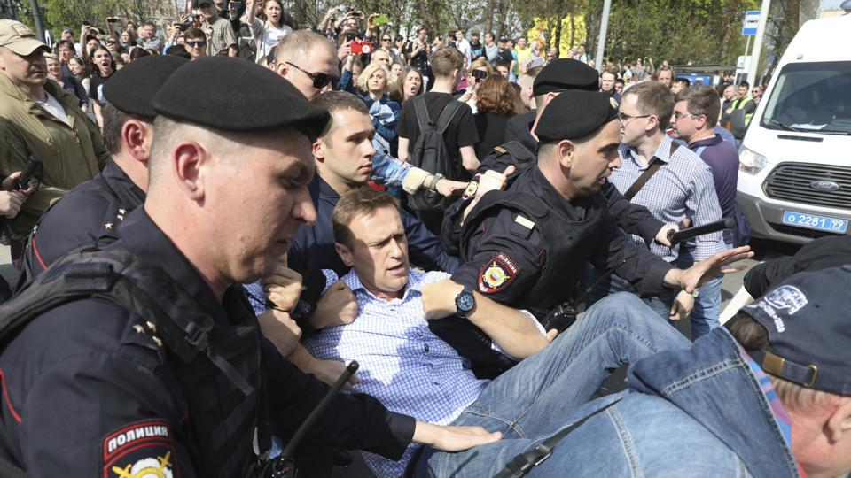 Russian police carrying a struggling opposition leader Alexei Navalny at a demonstration against President Vladimir Putin in Pushkin Square in Moscow, Russia, on Saturday.