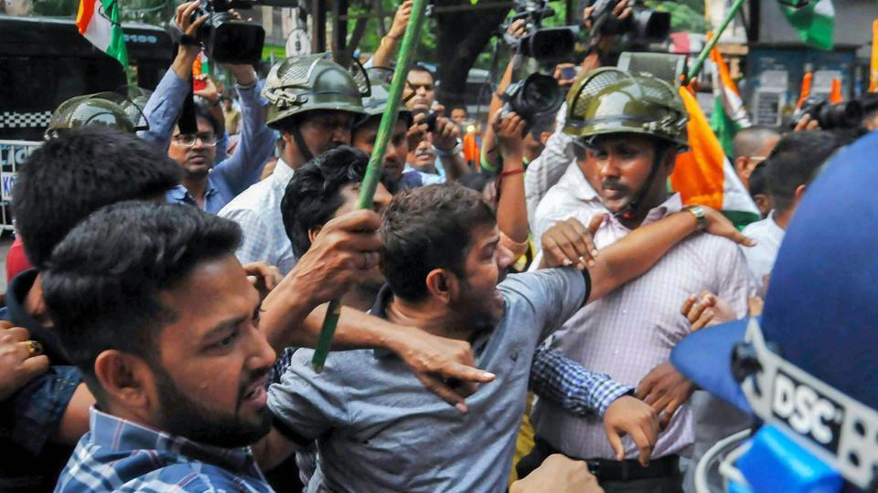 Police detain Congress activists who were protesting against fresh political violence in  Kolkata, on April 23..